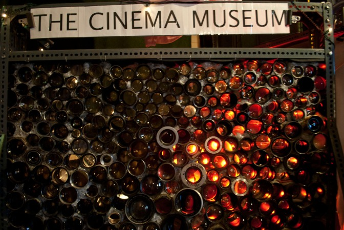 cinema-museum-event-space-chairs-screen-film-location-stage-theatre-memorabilia-old-classic-signs-vintage-corridor-hallway-film-location-camera-lenses